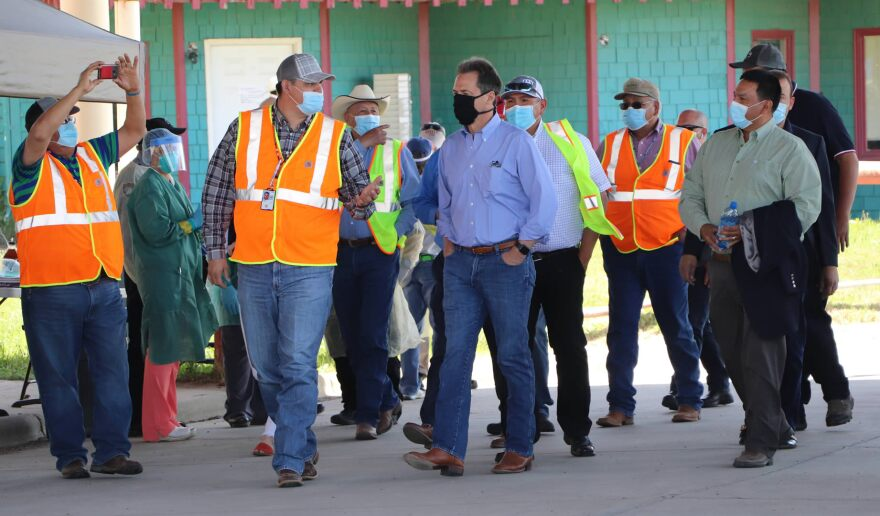 Gov. Steve Bullock (center) with Crow Nation Chairman AJ Not Afraid (R) and officials from the Indian Health Services at a community testing event in Crow Agency May 27, 2020.