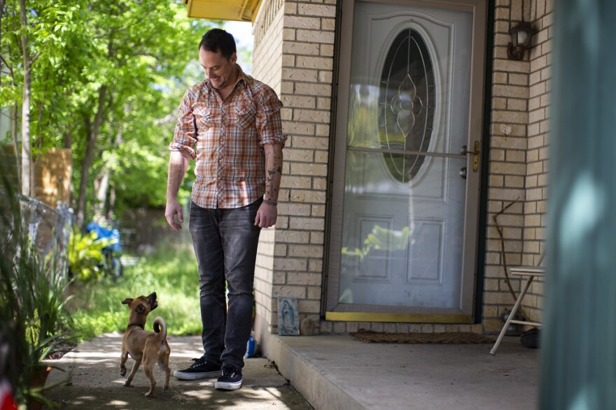 Kevin Dick with his dog Boogie in front of their house.