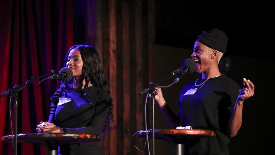 Podcast hosts Sydnee Washington and Marie Faustin play games on <em>Ask Me Another</em> as part of the Brooklyn Podcast Festival at the Bell House in New York.