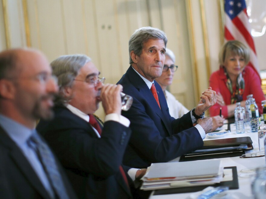 U.S. Secretary of State John Kerry meets with Iranian Foreign Minister Mohammad Javad Zarif (not pictured) at a hotel in Vienna on Friday.