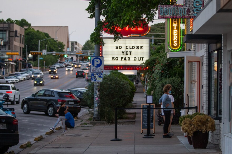 People venture out on South Congress as the state relaxes rules on bars and restaurants.