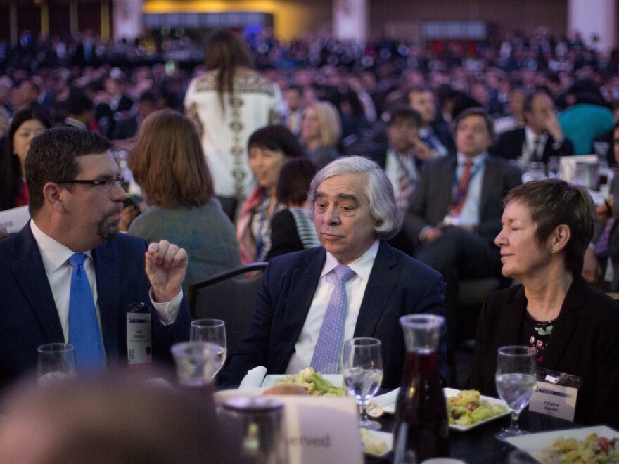 Energy Secretary Ernest Moniz (center) sits with other guests at the SelectUSA Investment Summit in Washington on Monday.