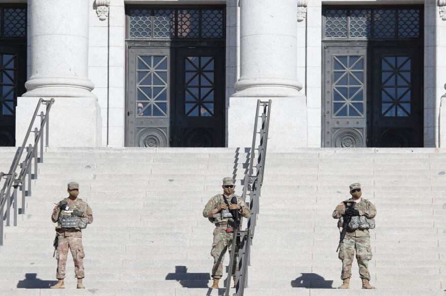 Utah National Guard troops patrol at the Utah State Capitol building during a nationwide protest called by anti-government and far-right groups supporting President Trump.