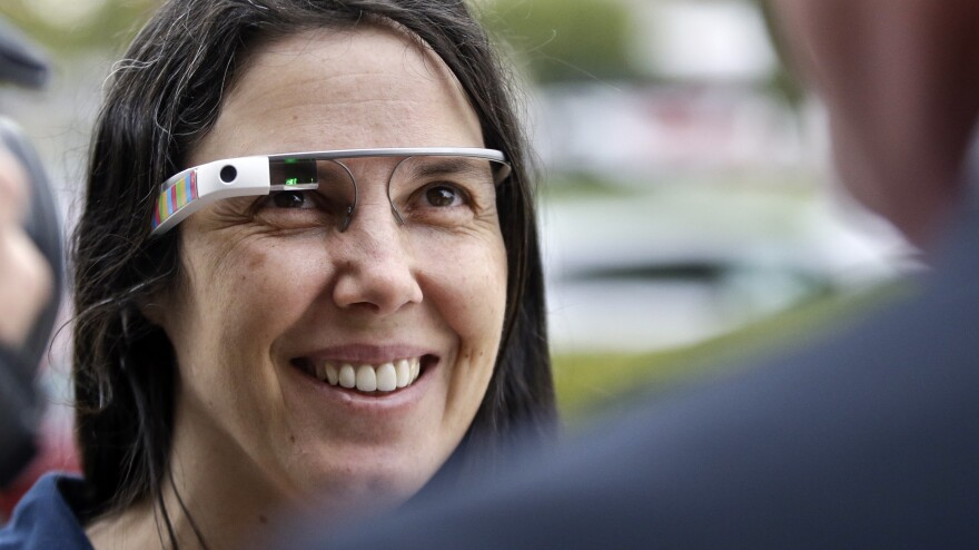Cecilia Abadie wears her Google Glass as she talks with her attorney outside traffic court in December. A California Highway Patrol officer gave Abadie two citations in October; she was cleared of both infractions Thursday.
