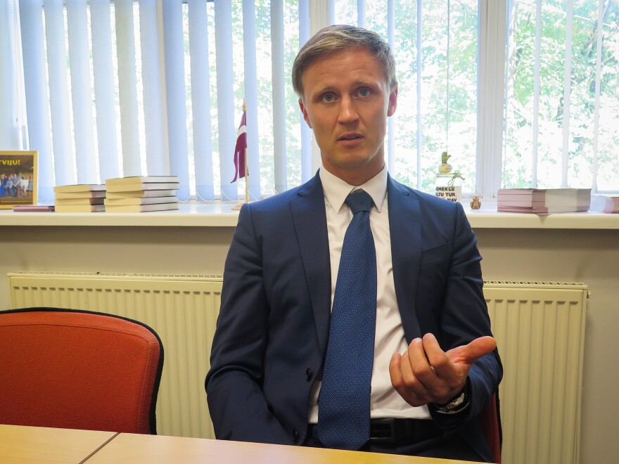 Rihards Kols is a nationalist member of Latvia's parliament who believes his country must protect its language from Russian influence.