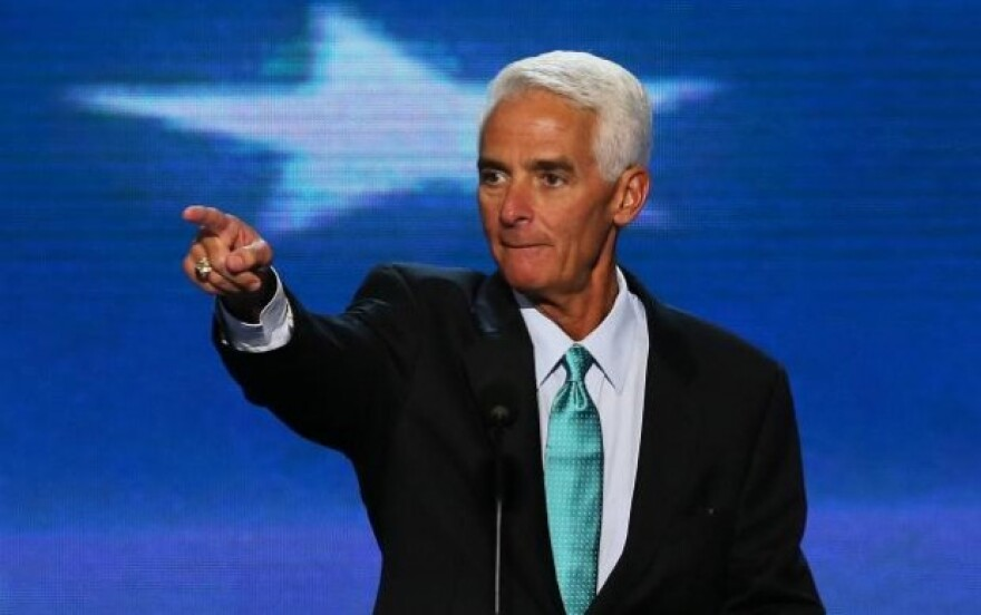 Congressman Charlie Crist points from a podium