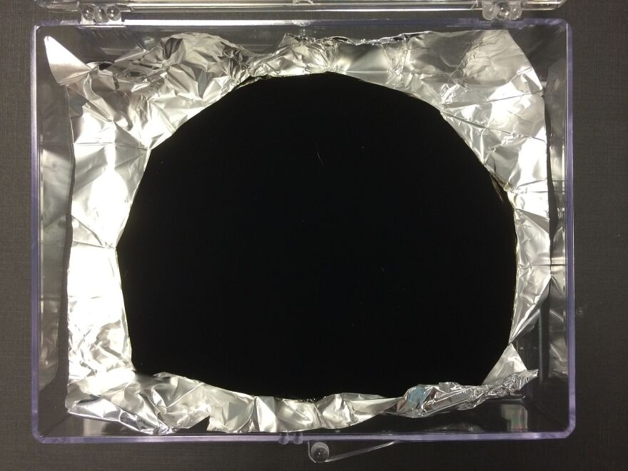 "Surrey NanoSystems, the U.K. company that makes Vantablack, describes it as ""a functionalised 'forest' of millions upon millions of incredibly small tubes made of carbon, or carbon nanotubes."""