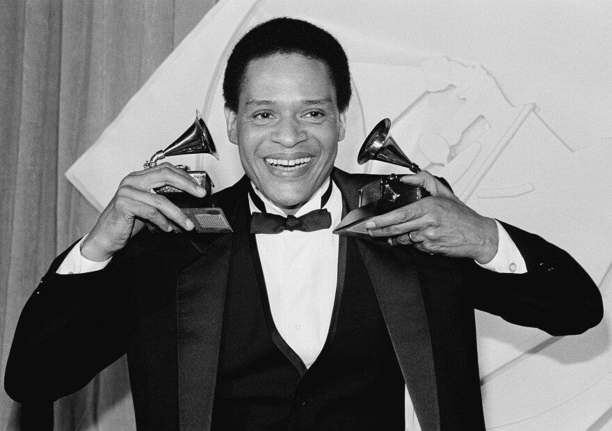 Al Jarreau celebrates after the 1982 Grammys in Los Angeles. Jarreau won honors that year for best pop male vocalist and best jazz male vocalist.