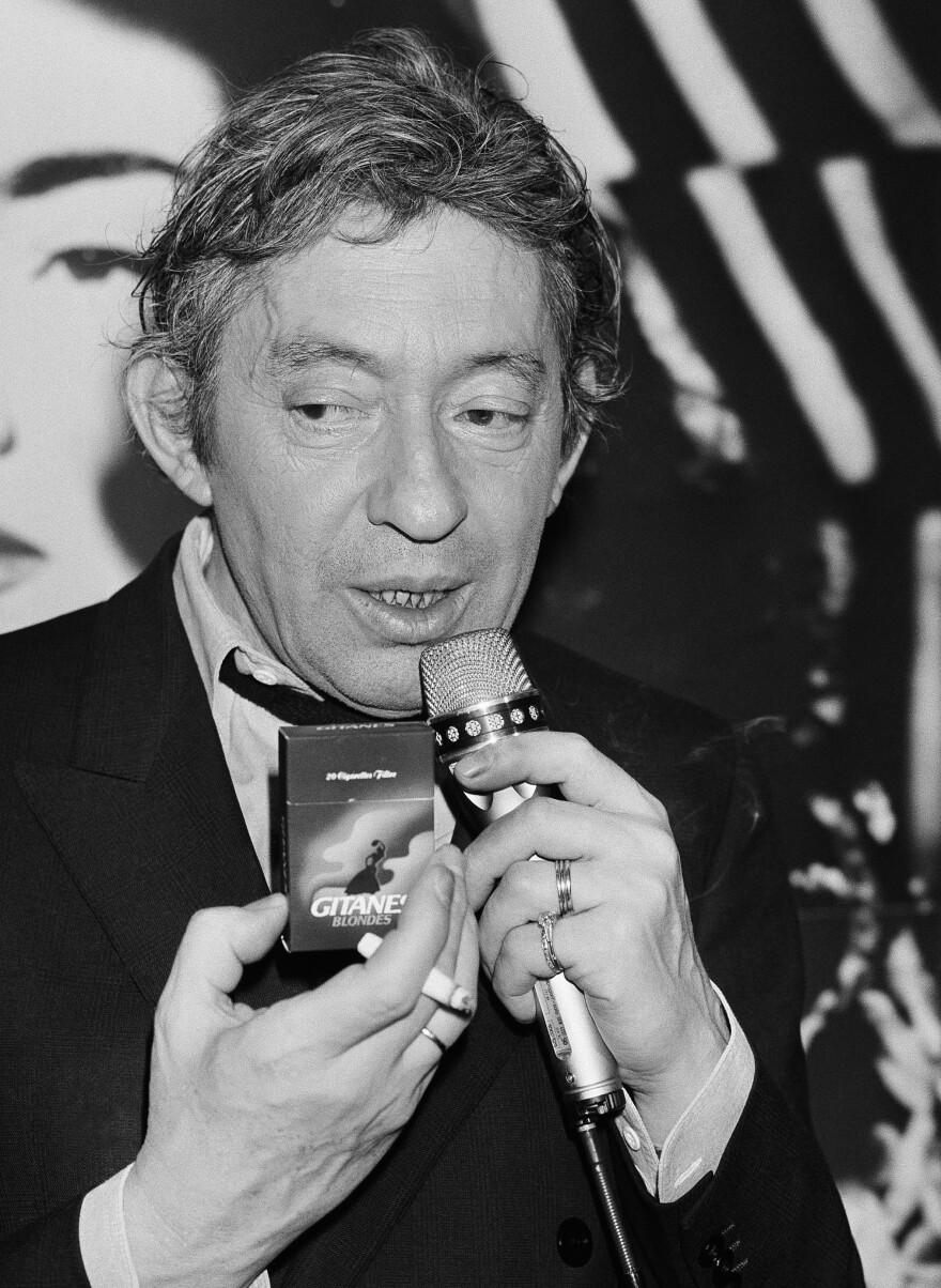 French singer, composer and well-known smoker Serge Gainsbourg presents the new Gitane Blonde cigarette at a press conference at Paris hotel George V, on April 29, 1986.
