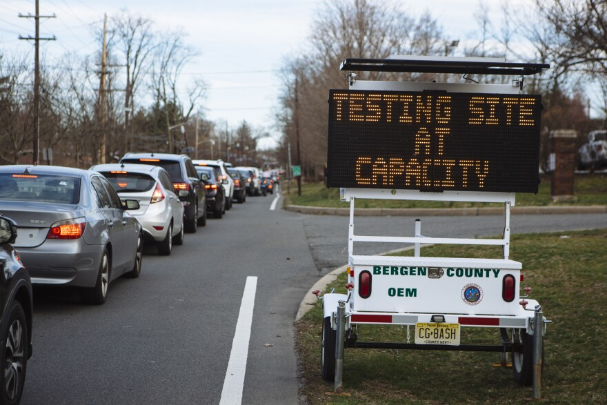 People wait in their vehicles for coronavirus testing at Bergen Community College in Paramus, N.J., last month.
