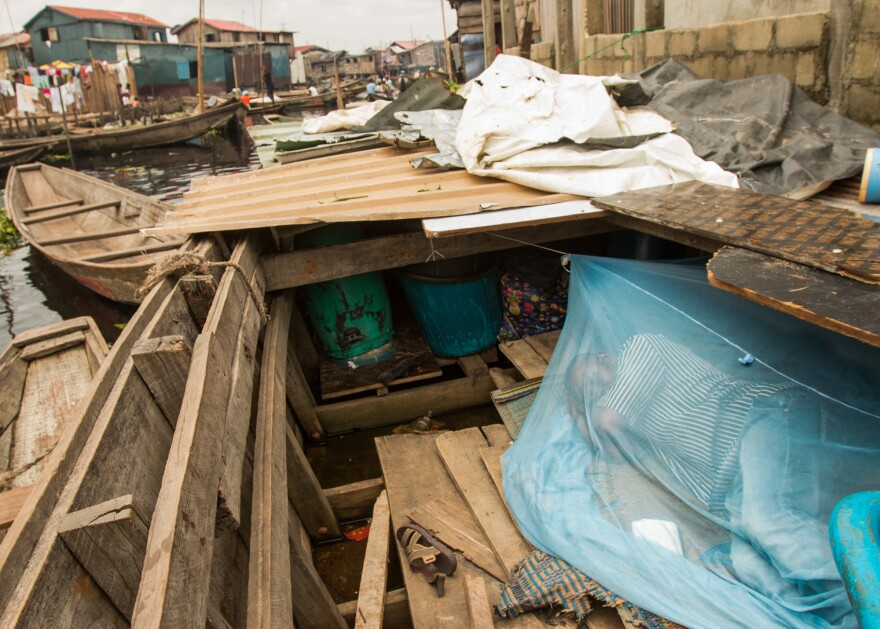 Salako Hunsa lives in a canoe in the Makoko waterfront settlement in Lagos, Nigeria. His home was burned down last month.