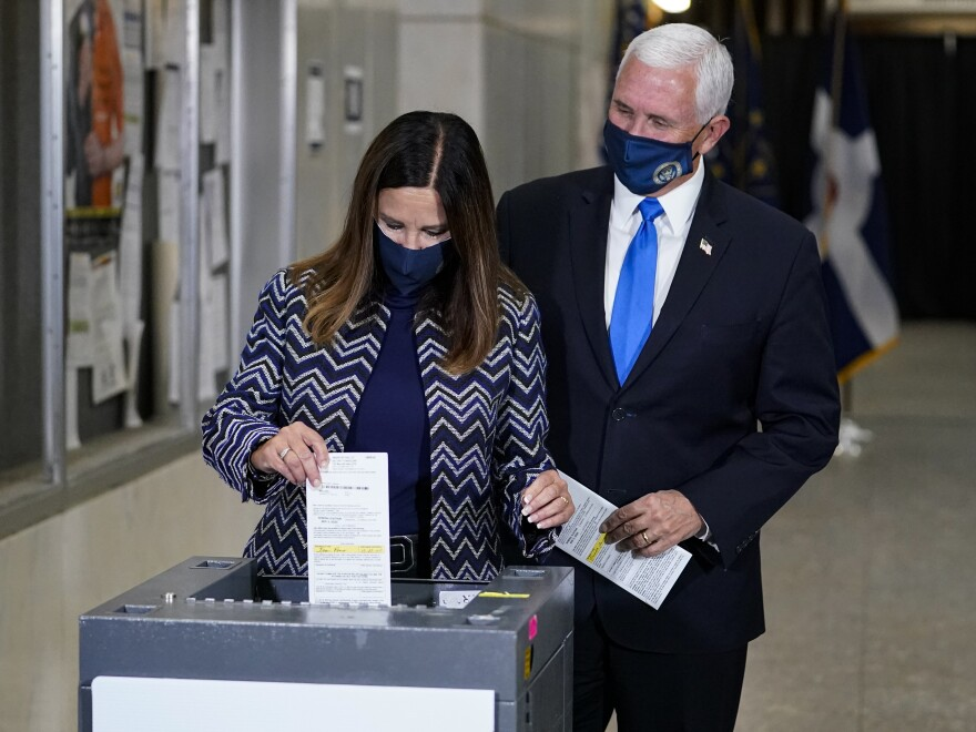 Vice President Mike Pence and his wife, Karen, cast their ballots during early voting in Indianapolis on Friday.