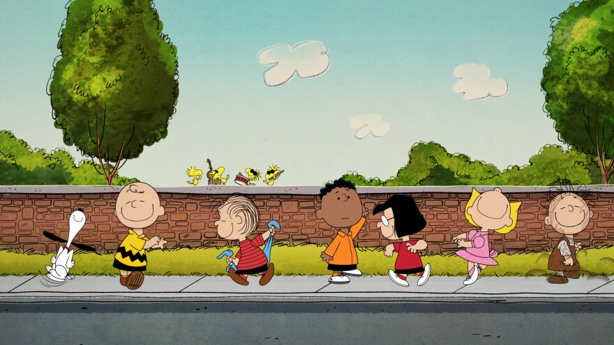 Snoopy, Charlie Brown, Linus and the rest of the 'Peanuts' gang dance to the accompaniment of a band of birds.