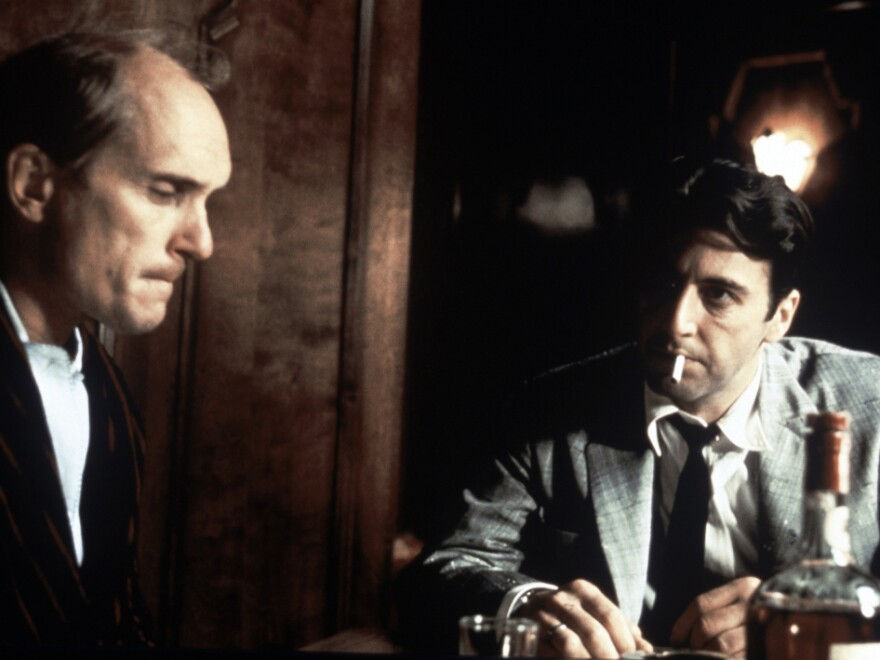 Robert Duvall and Al Pacino in a scene from <em>The Godfather Part II</em>.