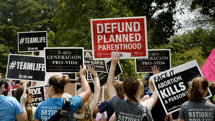 Anti-abortion activists held a rally opposing federal funding for Planned Parenthood in front of the U.S. Capitol on Tuesday.