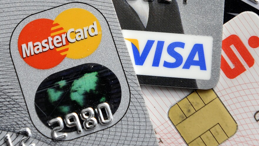 "By this time next year, U.S consumer are likely to be using credit cards with electronic chips, like these in Germany. But such cards are expected to stop only 60 percent of fraud, prompting a retailers' spokesman to call them the ""not-so-smart card."""
