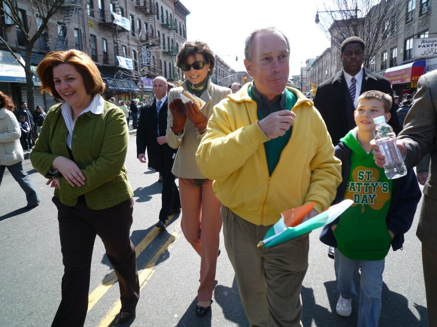 Then-Mayor Michael Bloomberg, center in yellow, walks in a New York City parade in 2009.