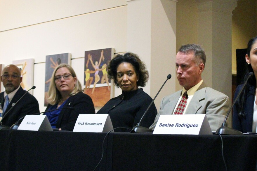 Kim Neal, center, has been named Fort Worth's first police monitor.