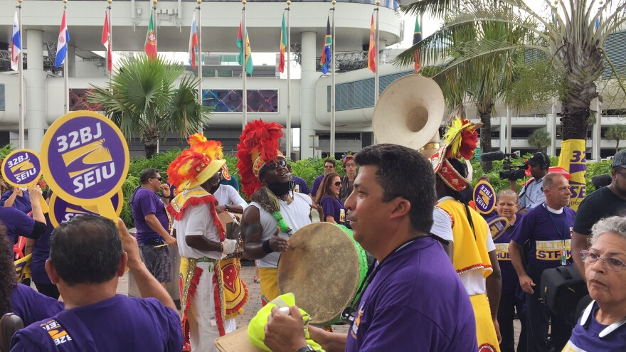 Jose Ferrer, fore, marches to the beat of a Junkanoo band to kick off his and others' strike against Ultra Aviation.