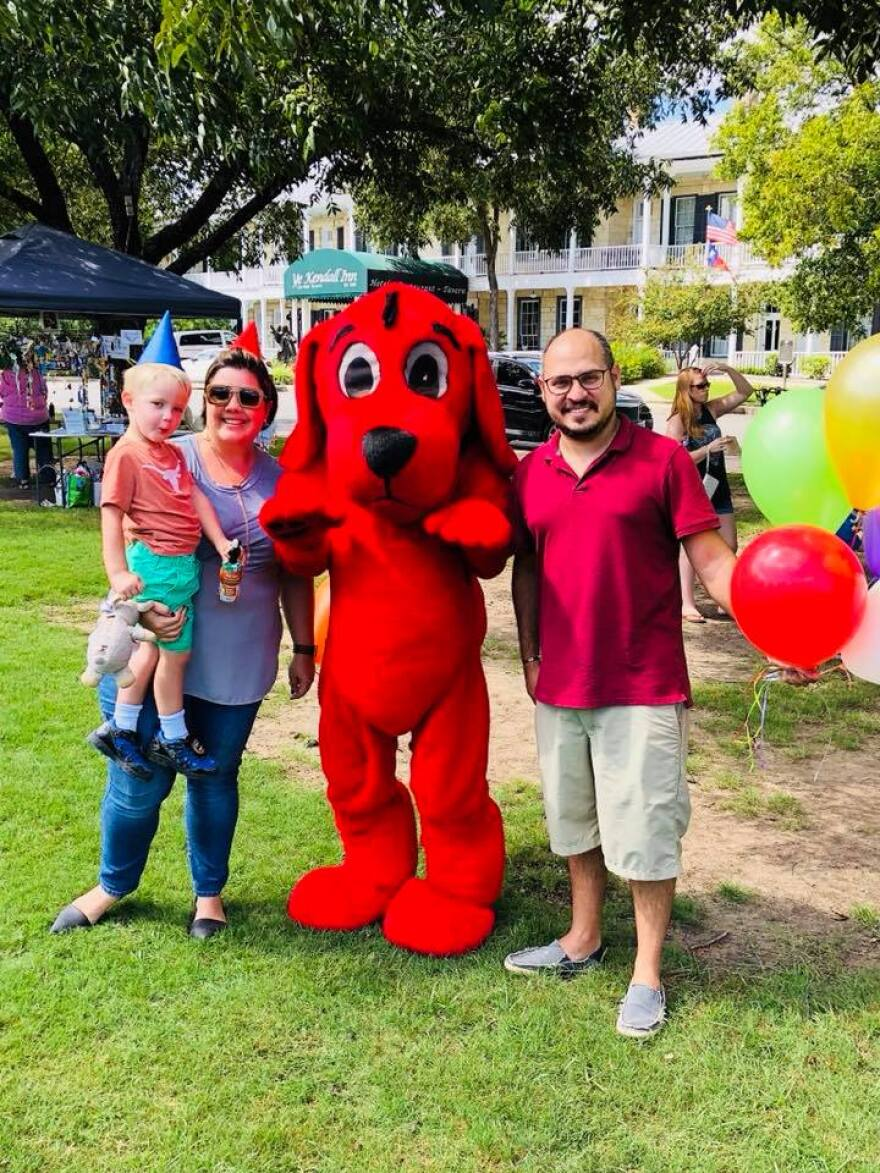 A family poses with Clifford the Big Red Dog at the Boerne Book and Arts Festival.