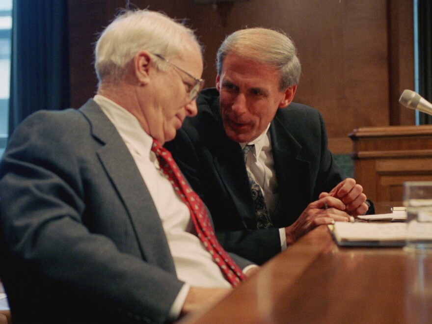 Sen. Dan Coats, right, talks with Sen. John S. McCain prior to testifying before a Senate Budget Committee hearing in  1995.