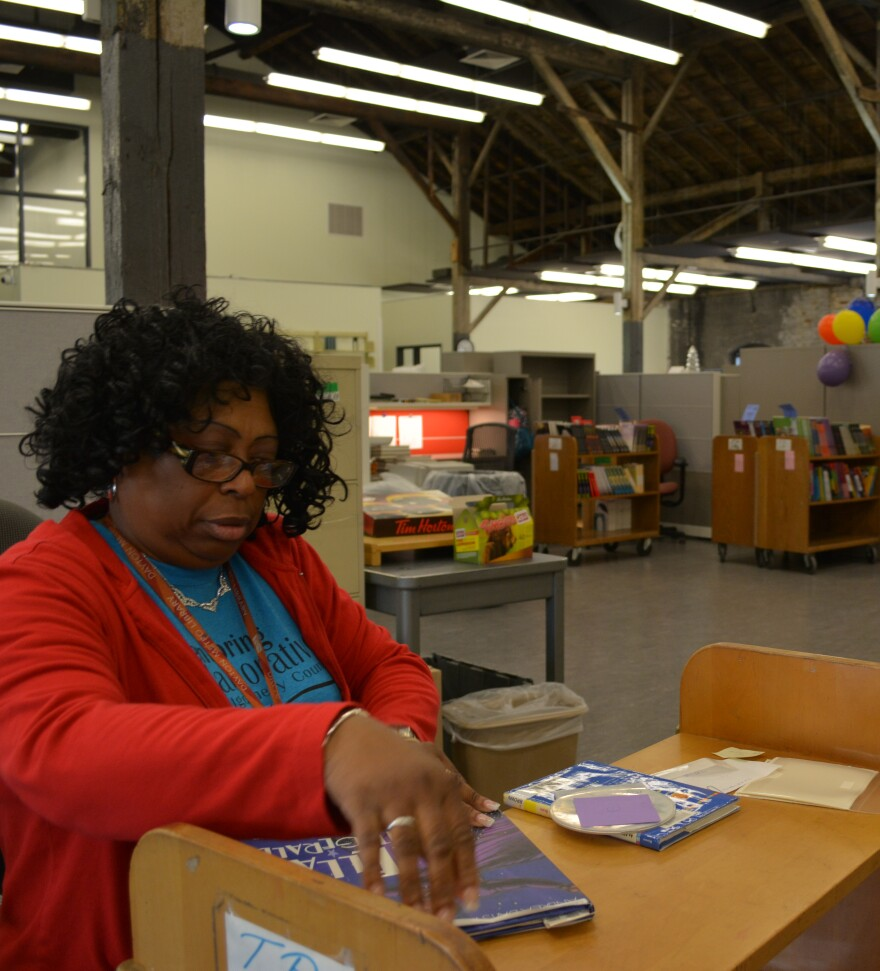 Tanya Thomas Smiley processes new books in the fourth floor workspace at the new Dayton Metro Library operations center.