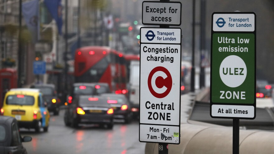 Signs in London designate the Ultra Low Emission and Congestion Charging zones for cars driven into the city's center.