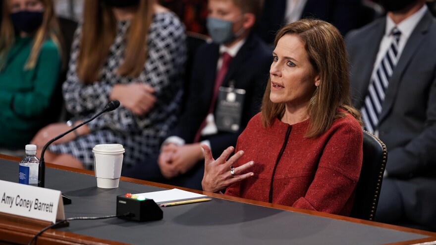 President Trump's Supreme Court nominee Judge Amy Coney Barrett testifies during the second day of her Senate Judiciary confirmation hearing on Tuesday.