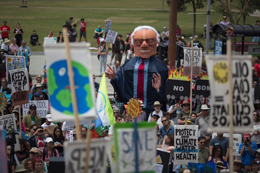 An oversized puppet of Democratic presidential candidate Bernie Sanders stands above demonstrators at the March to Break Free from Fossil Fuels on Saturday in Los Angeles.