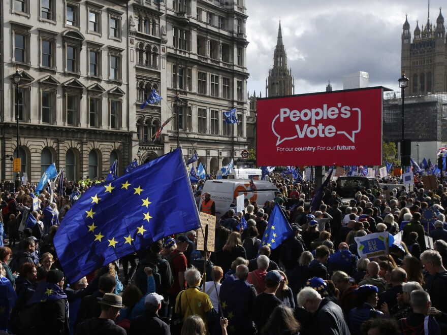 Demonstrators hold European Union flags and banners during a People's Vote march in London on Saturday.
