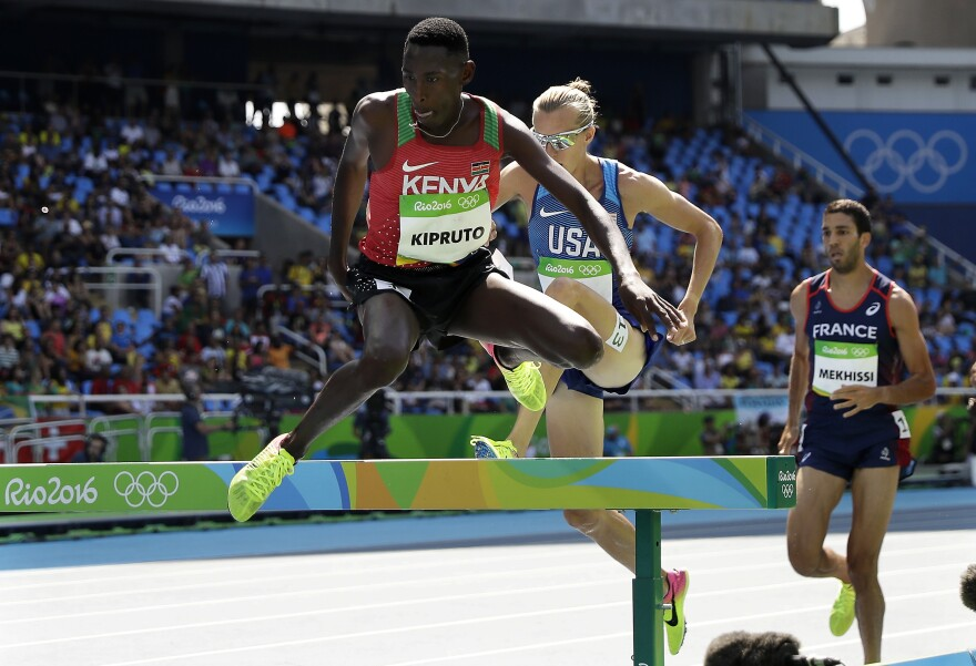 Kenya's Conseslus Kipruto leads America's Evan Jager and France's Mahiedine Mekhissi in the men's 3,000-meter steeplechase in Rio on Wednesday. Kipruto won in an Olympic record of 8:03:28. Jager finished second and Mekhissi was third. Kenya has won four gold medals in distance running in the past four days.