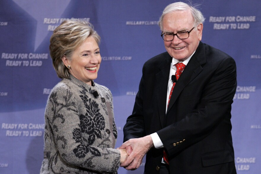 Warren Buffet is a supporter of Hillary Clinton, seen here campaigning with her in 2007. His company, Berkshire Hathaway, received low marks for transparency around its political spending.