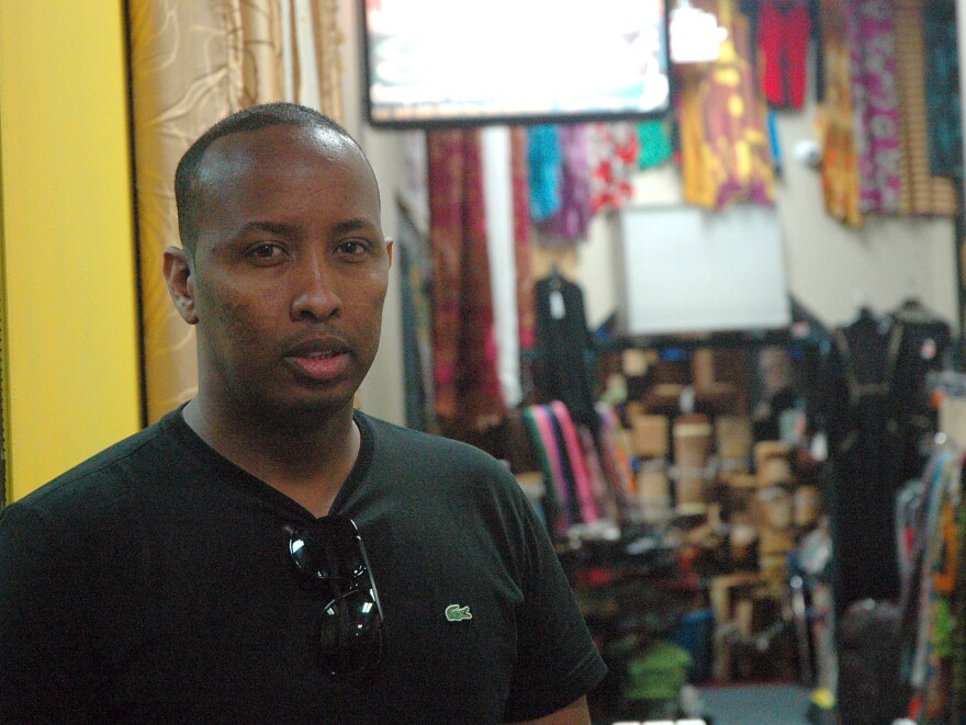 Goth Ali, 28, works at a cellphone shop in the Village Market, a Somali-American mall in Minneapolis. Ali says he wires $400 to $500 every month to relatives in East Africa.