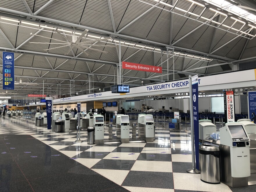 The nearly deserted check-in area at Terminal 1 of Chicago's O'Hare airport reflects the sharp decline in air travel, as the number of people flying has plummeted more than 90% since the beginning of March.