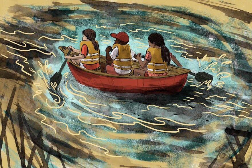 Three kids canoeing together