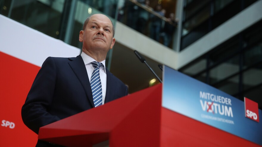 Acting chairman of the Social Democrats (SPD) Olaf Scholz announced that party members backed forming a new coalition government with Angela Merkel's Christian Democrats.