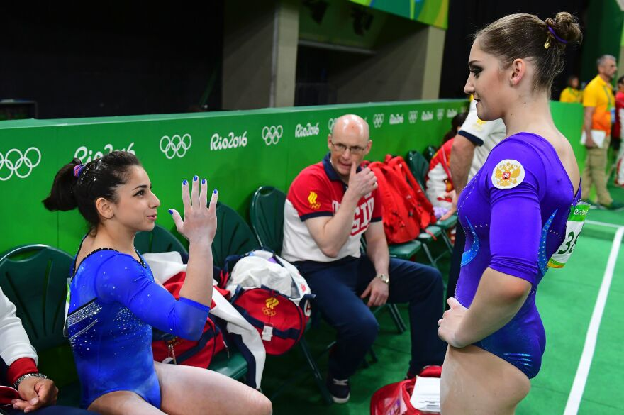 Russia's Aliya Mustafina (right) speaks with teammate Seda Tutkhalian at the women's individual all-around final of the Artistic Gymnastics.