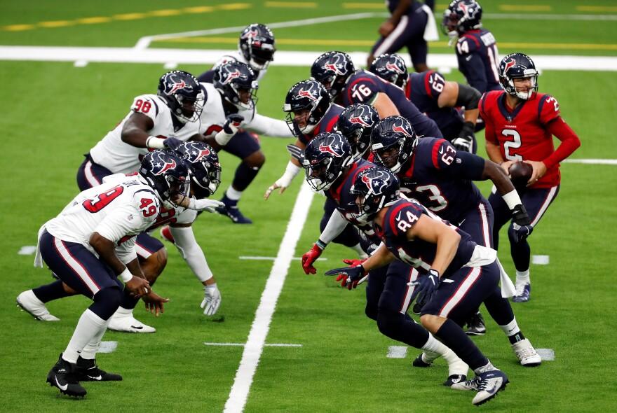Houston Texans quarterback AJ McCarron (2) runs a play during an NFL training camp football practice Thursday, Aug. 27 in Houston.