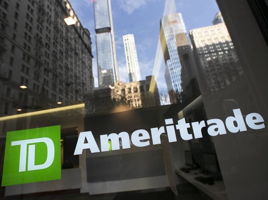 The logo for TD Ameritrade appears on an office window for the company. Trading apps are seeing a boom in customers as people flock to trading stocks during the pandemic.