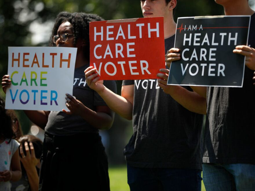 Demonstrators held signs outside the U.S. Capitol in Washington DC on June 26, 2018 while Democratic leaders called on the Trump administration to uphold the preexisting conditions provision of the Affordable Care Act. Now the issue may be decided in court.