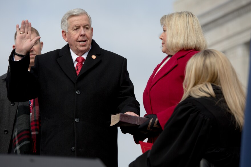 Judge Sarah Castle (right) administers the oath of office to governor Mike Parson (left) with First Lady Teresa Parson during the Missouri Bicentennial Inauguration on Monday, January 11, 2021, at the Missouri State Capitol Building in Jefferson City. Gov. Parson has served as Missouri's governor since June 1, 2018, when then-Gov. Eric Greitens resigned.