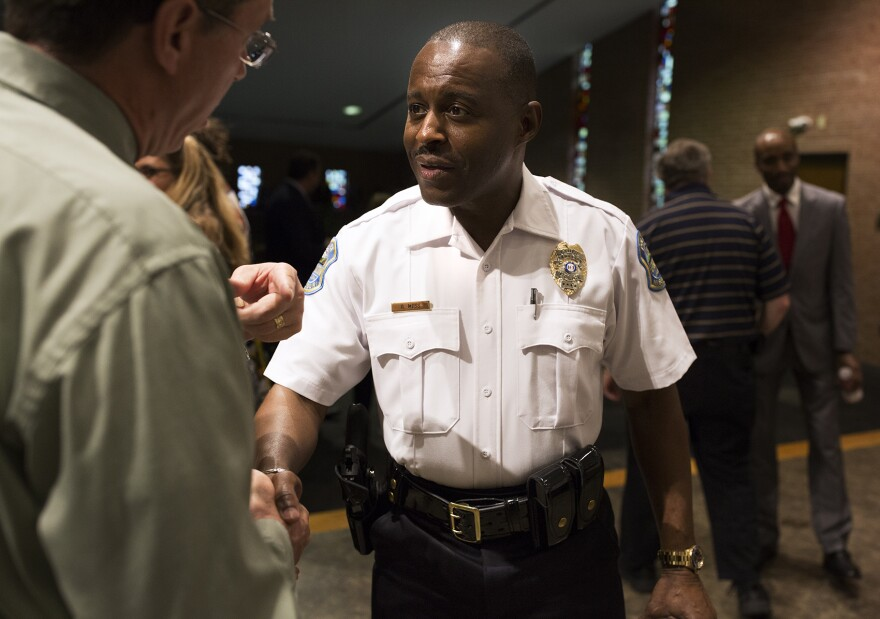Ferguson Police Chief Delrish Moss greets attendees at his swearing-in ceremony.