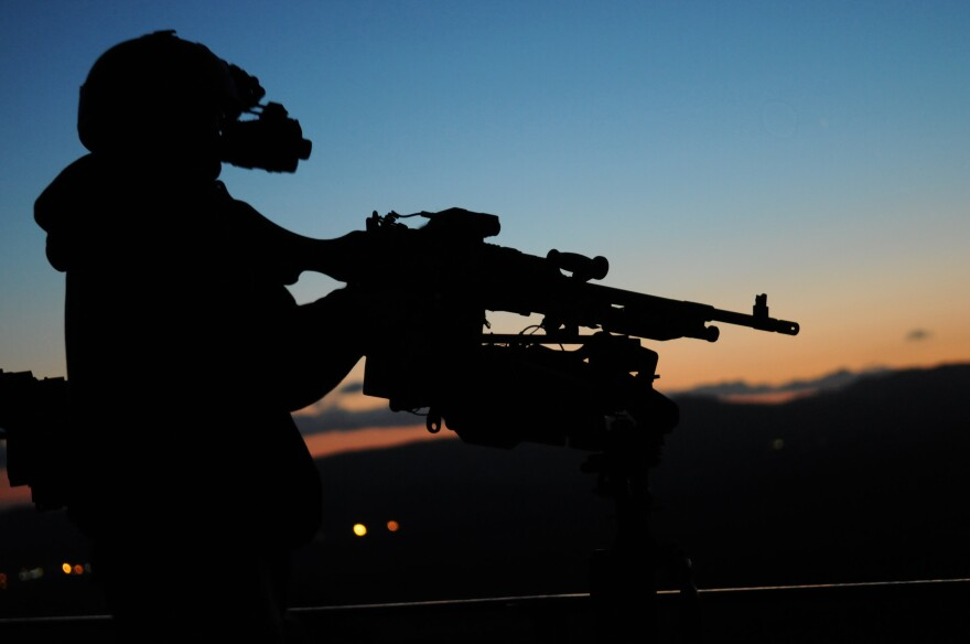 A crewman qualification training instructor tests his night vision equipment.