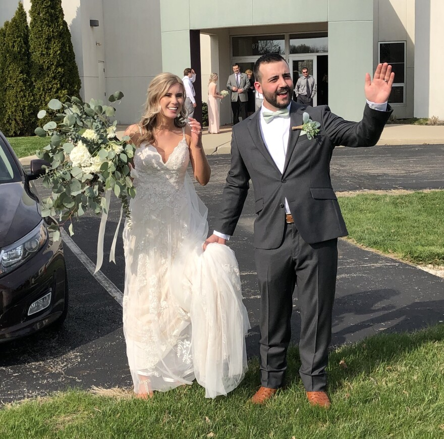 Madison McHugh McGraw and Grant McGraw greet guests in parking lot
