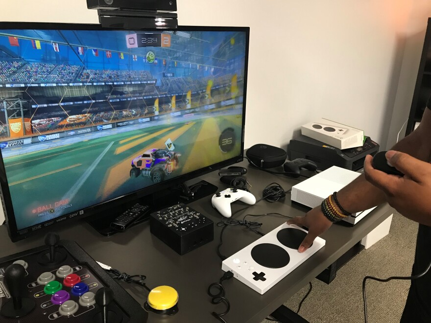 AbleGamers' employee Greg Haynes uses an Xbox One adaptive controller to play a game called Rocket League.