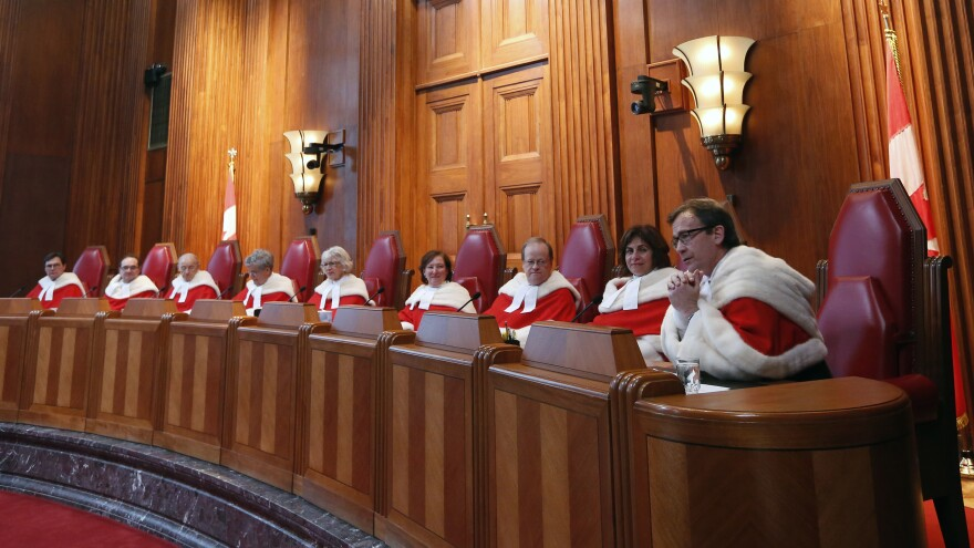 The Supreme Court of Canada, seen here in a welcoming ceremony last October, has overturned the country's ban on physician-assisted suicide.