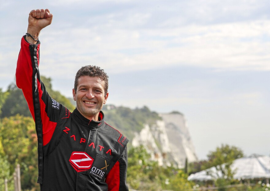 Zapata celebrates on Sunday after crossing the English Channel on a jet-powered hoverboard.