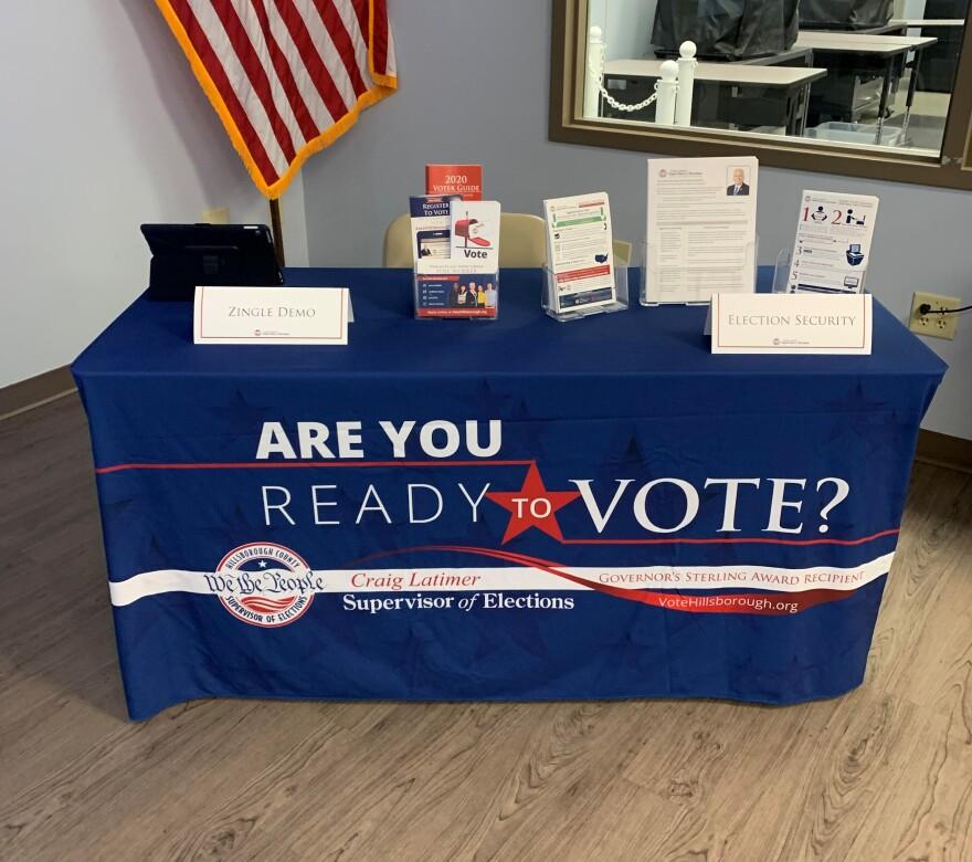 A voter registration table.