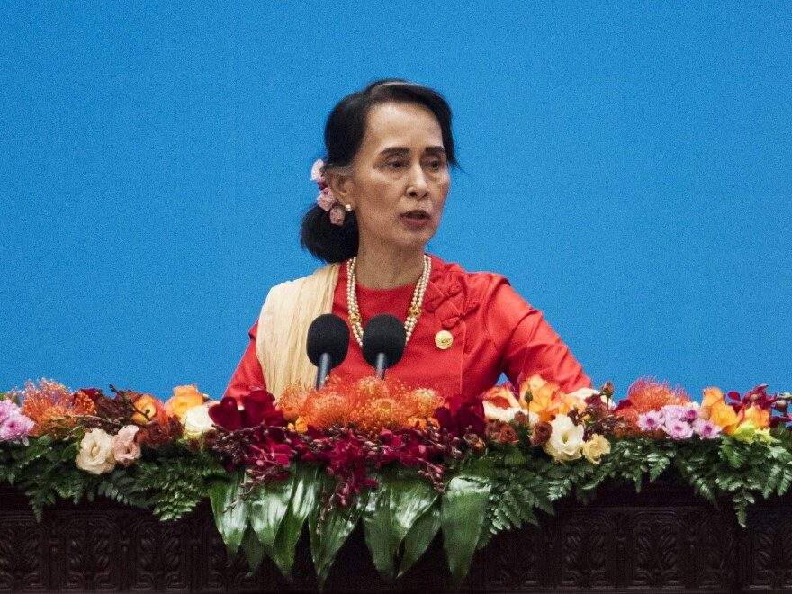 Myanmar's civilian leader Aung San Suu Kyi gives a speech this month in Beijing. The U.N. human rights chief says she could be held responsible for her country's brutal treatment of the Rohingya.