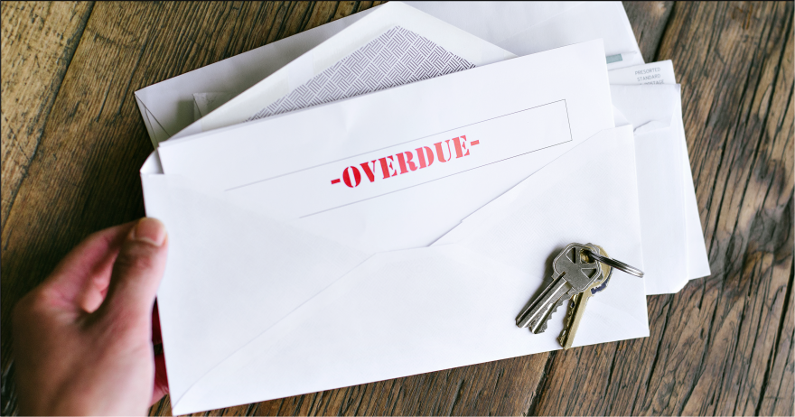 Photo illustration showing an open envelope with a note in side that says overdue